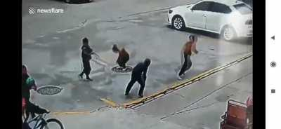 Kid throws fire cracker in manhole and gets a jump