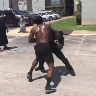 Cop spars guy on the street