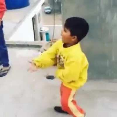 Kid gets angry while flying a kite.