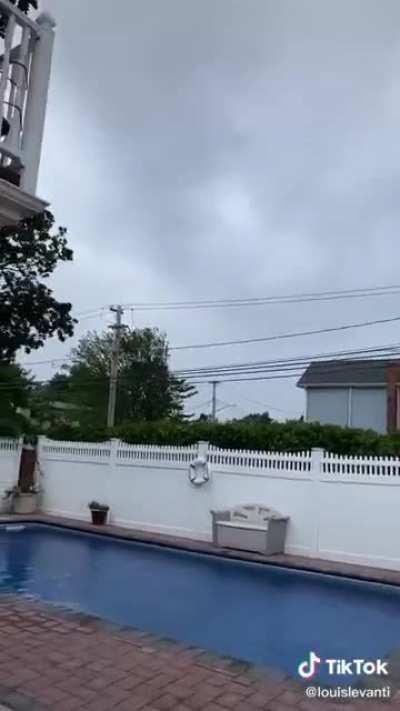 Going outside during a tropical storm (@louislevanti - TikTok)