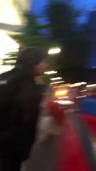 Enraged man randomly attacks woman through her vehicle's window, street mod ensures