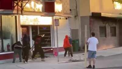 [May 2020] Young woman pleads for peace with group of George Floyd rioters who want to rob a nearby jewelry shop. The rioters immediately beat her and her husband savagely with 2x4's