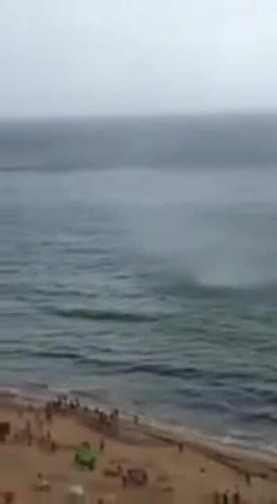 A sea tornado hits the shore of a Brazilian beach
