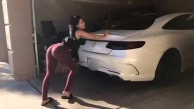 Lia pushing her car