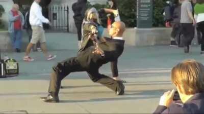 Street artist sells fighting photo shots