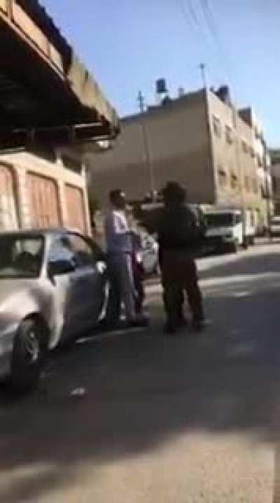 Israeli Soldier Points Gun at Unarmed Arab Man Walking With His Young Son