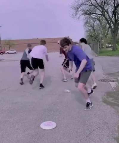 Whoever the bottle points at tries to hit the others with the frisbee
