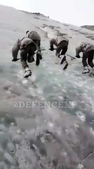 Soldiers Climbing Stepp Mountains On Kargil.