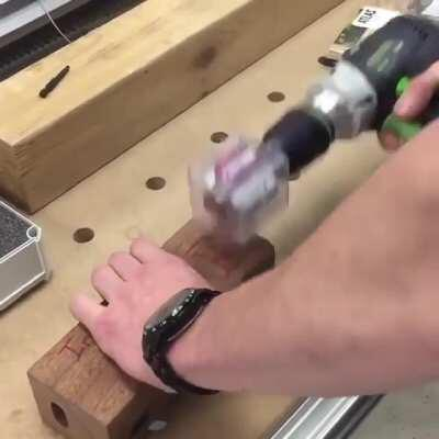 Tightening hidden fasteners in wood with a spinning magnet (Lamello Invis Mx2)