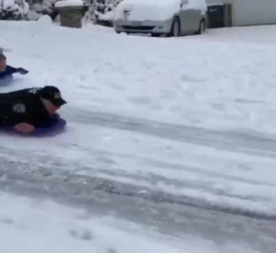 Someone called the police on kids sledding down a road so the cops investigated