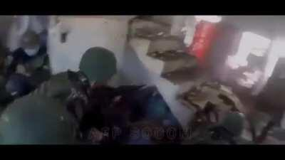 A .50cal HMG position inside a house/bldg raining lead to the enemy during the siege of Marawi, 2017