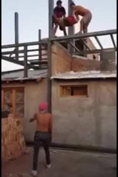 Catching bags of cement from a roof