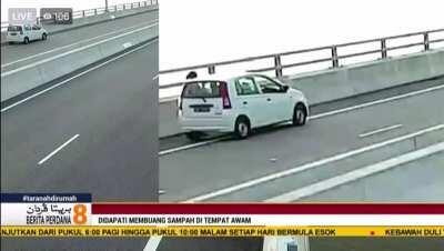 CCTV footage of an irresponsible driver dumping rubbish off Temburong Bridge. This is why we can't have nice things.