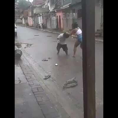 Woman and Little Person dukes it out in the streets of Brazil