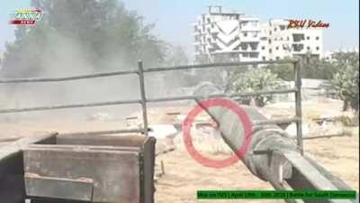 FSA soldier fires at SAA tank from close range with rifle, tank returns fire, 2018