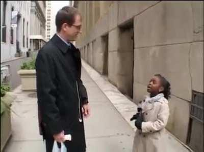 Young reporter asks probing questions while on Wall Street, Questions such as: