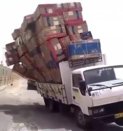 WCGW with a stack of boxes twice the heoght of the truck?