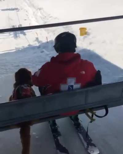 This professional snow rescue pupper doing a great job of getting on the chairlift