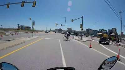 Old man bicyclist decides to take a left last second with no hand signal