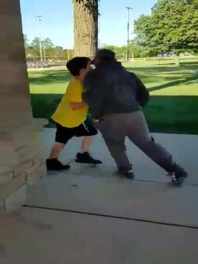 Kid tries to fight an older man