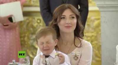 X-post from r/instantregret. little kid eats a lemon at ceremony