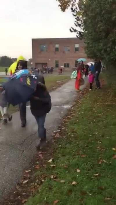 Dad picks up daughter from school in a chicken suit.