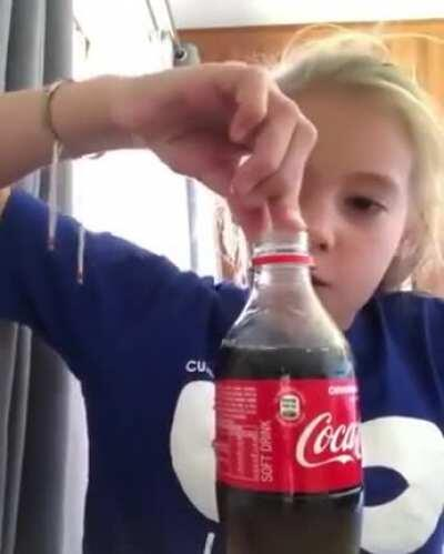 This kid desperate for cold drink.