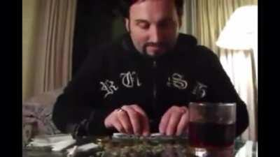Julian tries rolling a six paper joint for himself.