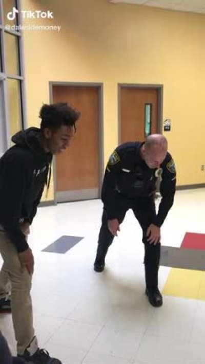 Cop and student have a race