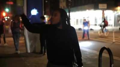 Black woman powerfully scolds rioters who are destroying low income neighborhood