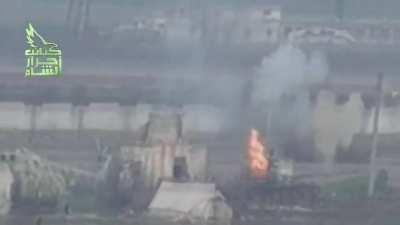 Rare footage of a tank VS tank kill. Rebel tank blows up SAA tank in regime helicopter base. January 2013. Syria.
