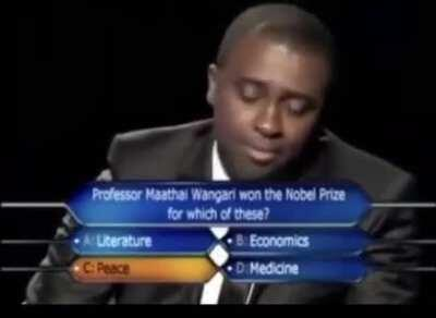 "Presenter lets the contestant down gently after answering the final question on Nigerian ""Who Wants to Be a Millionaire?"""