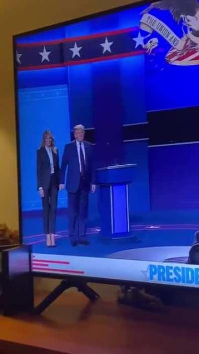 Joe Biden gets a hug from Jill Biden. Trump tries to force something from Melania.