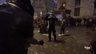 French protesters fighting against the police in order to liberate one of their member