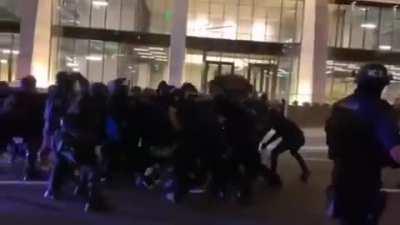 Portland police running into an antifa phalanx