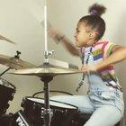 9 year old drummer Nandi Bushell rocks QOTSA