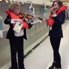 Outstanding. Violinists playing the Titanic bands song as the ship sank, but in the Toilet Paper aisle of the supermarket. Wearing life jackets and all.