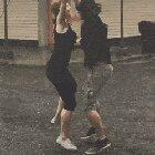 This couple dancing in the rain.