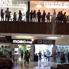 Mall is flooding and the band plays an appropriate song