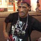 [NSFW] Man showcasing hits nuts in a public street