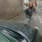 Woman refuses to move for car, driver beeps horn...... And then this